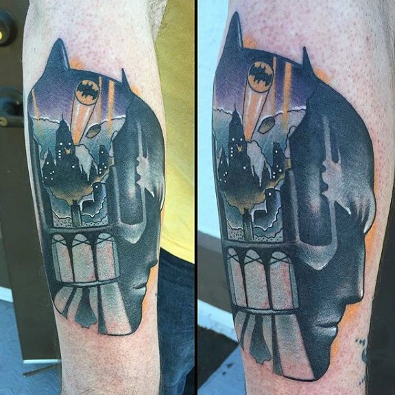 New school style colored forearm tattoo of Batman head stylized with night city