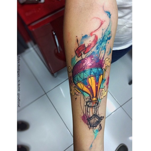 New school style colored forearm tattoo of balloon with stars