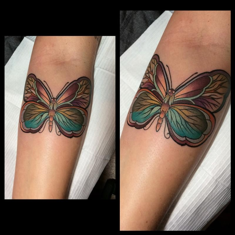New school style colored forearm tattoo of fantasy butterfly