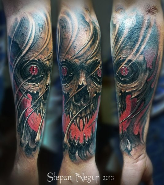 New school style colored forearm tattoo of demonic skull