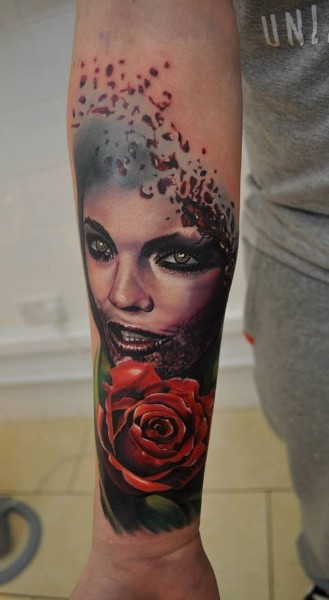 New school style colored forearm tattoo of bloody woman with rose