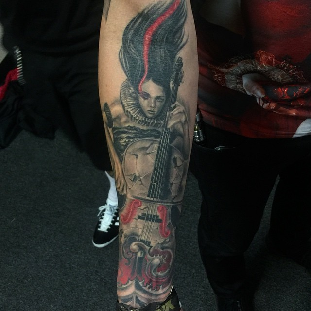 New school style colored forearm tattoo of woman musician