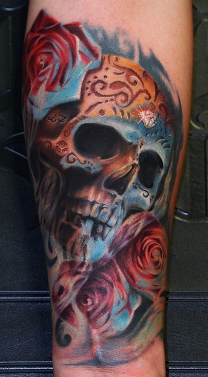 New school style colored forearm tattoo of human skull stylized with ornaments and roses