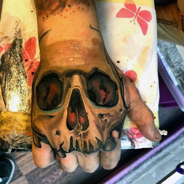 New school style colored hand tattoo of human skull