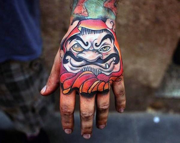 New school style colored hand tattoo of daruma doll head
