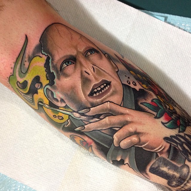 New school style colored Harry Potter movie villain tattoo on forearm