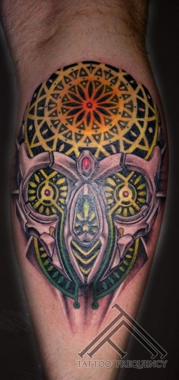 New school style colored leg tattoo of illustrative skull with ornaments