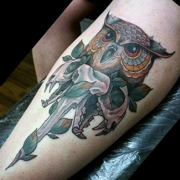 New school style colored leg tattoo of owl with cat skull