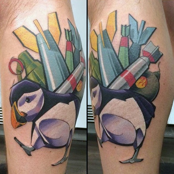 New school style colored leg tattoo of bird with bombs