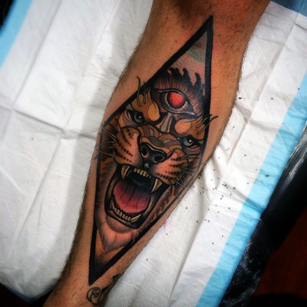 New school style colored leg tattoo of demonic lion face with black triangle