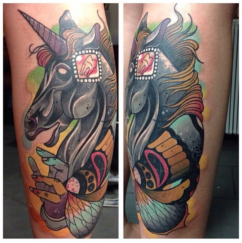 New school style colored leg tattoo of unicorn with human hand