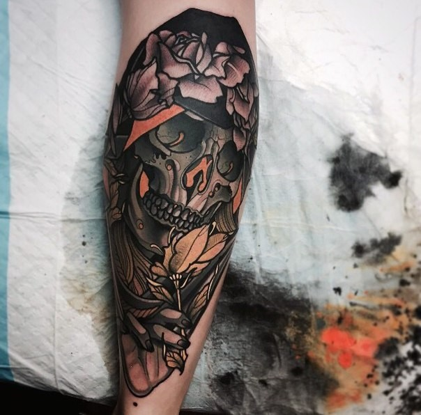 New school style colored leg tattoo of fantasy skull with flowers