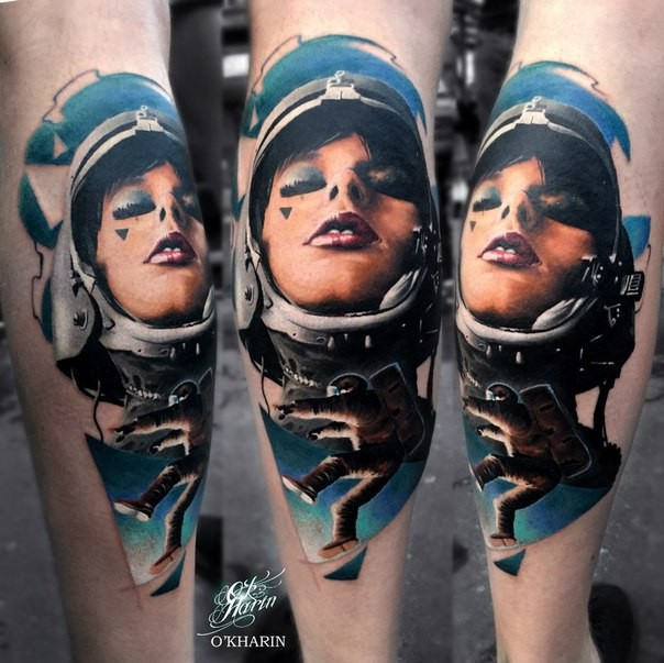 New school style colored leg tattoo of woman astronaut