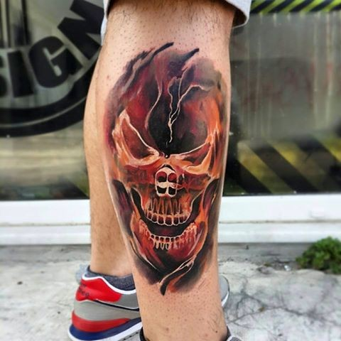 New school style colored leg tattoo of human skull