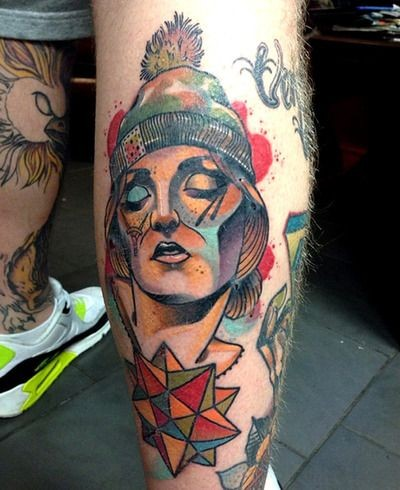 New school style colored leg tattoo of woman face with ornaments and hat