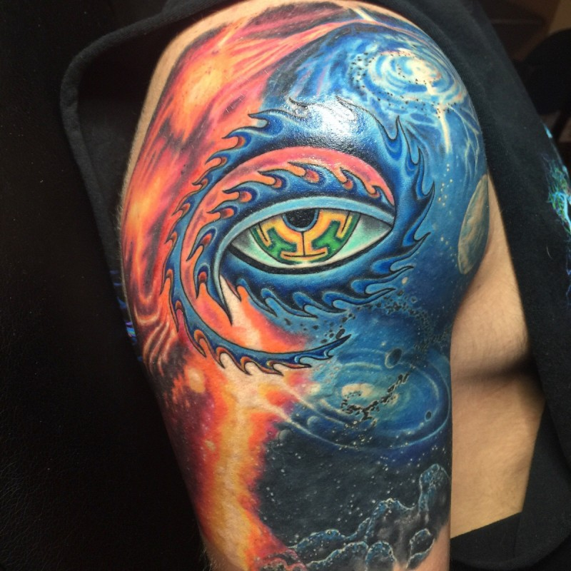 New school style colored mystical eye in space tattoo on shoulder