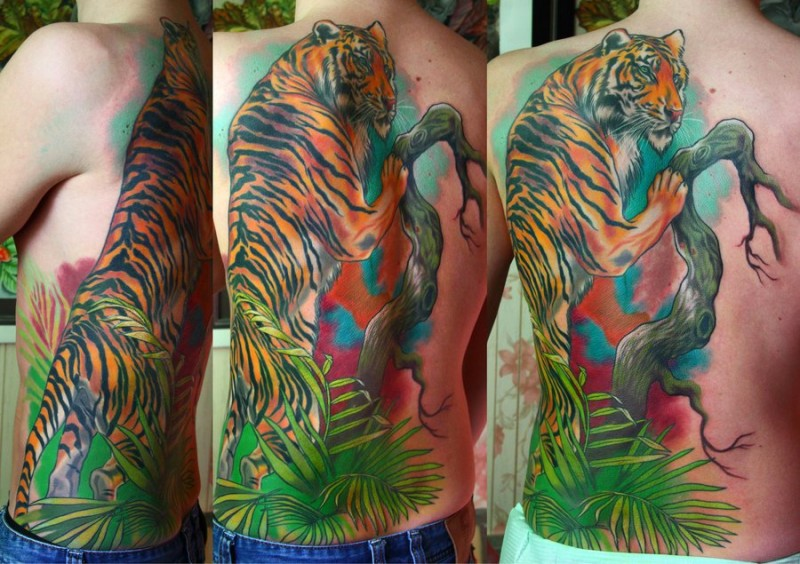 New school style colored natural looking tiger tattoo on back with tree and plants