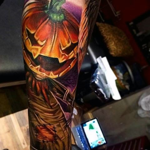 New school style colored scare crow tattoo on forearm