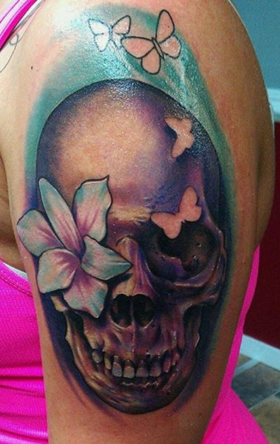New school style colored shoulder tattoo of human skull with flowers and butterfly