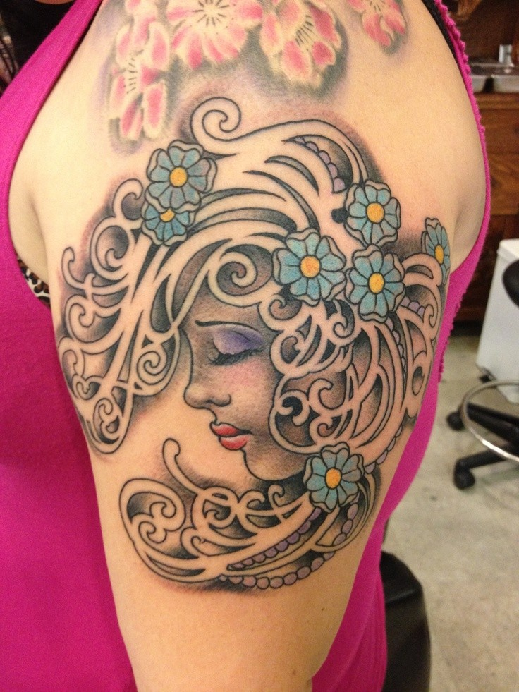 New school style colored shoulder tattoo of woman portrait with flowers