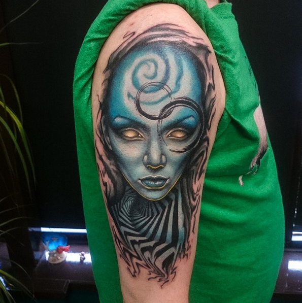 New school style colored shoulder tattoo of alien woman face