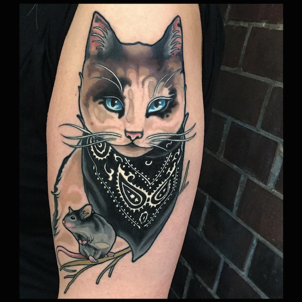 New school style colored shoulder tattoo of cat with little mouse