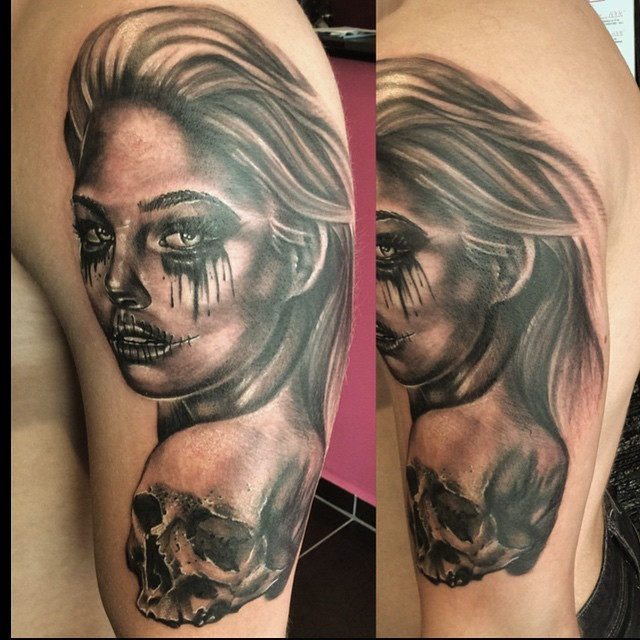 New school style colored shoulder tattoo of crying woman and human skull