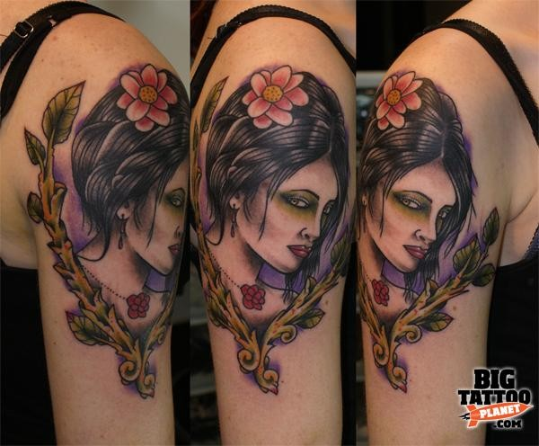 New school style colored shoulder tattoo of woman portrait with flower in hair