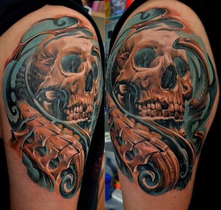 New school style colored shoulder tattoo of human skull and bones