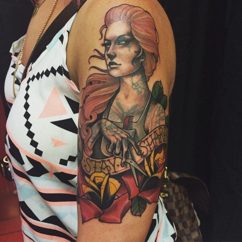 New school style colored shoulder tattoo of woman with lettering and flowers