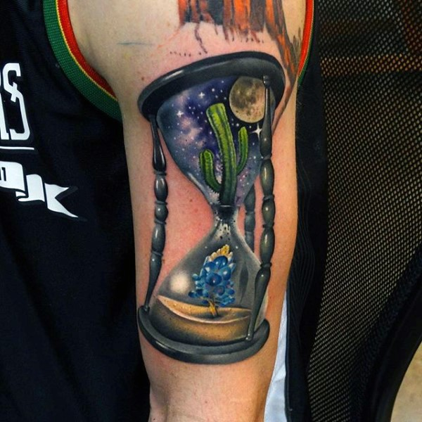New school style colored shoulder tattoo of big sand clock with cactus and small flower