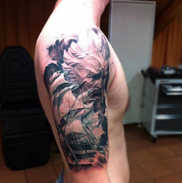 New school style colored shoulder tattoo of sailing ship and Poseidon god