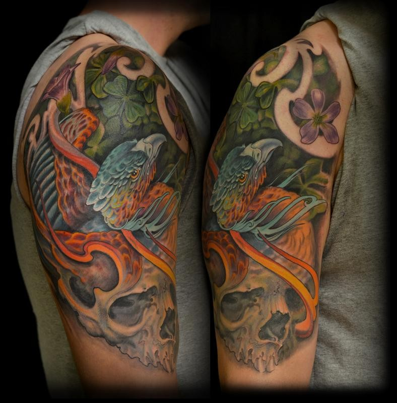 New school style colored shoulder tattoo of phoenix bird and clover