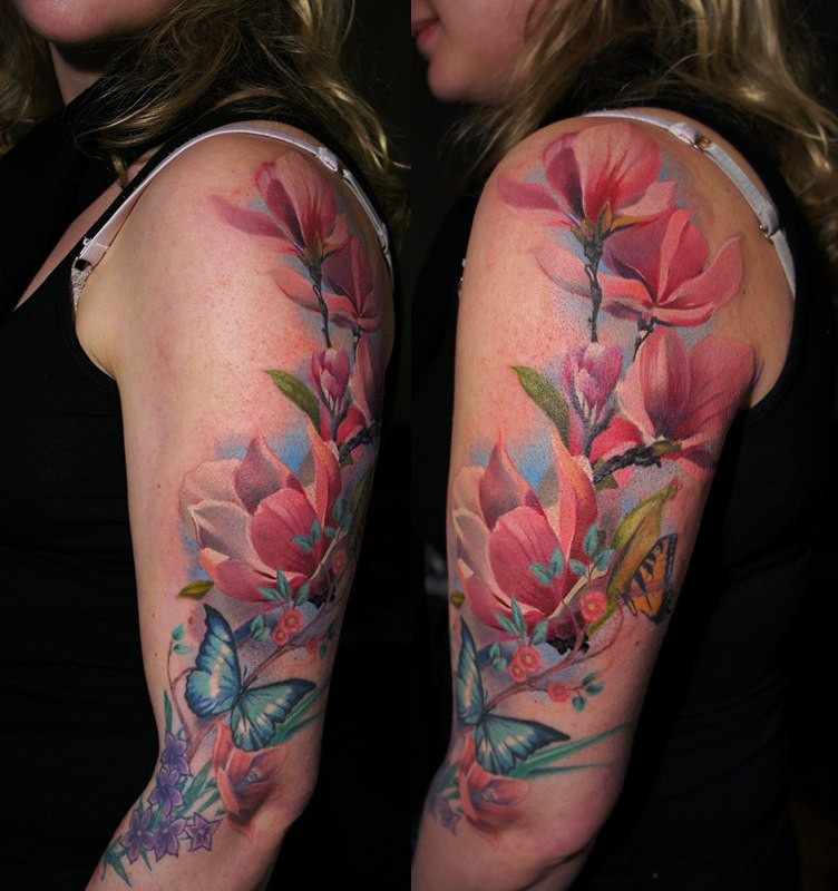 New school style colored shoulder tattoo of beautiful flowers and butterflies
