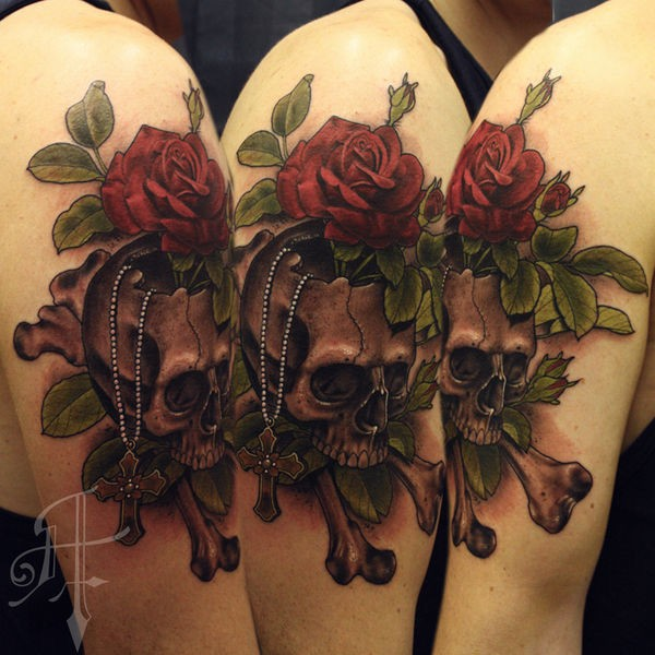 New school style colored shoulder tattoo of human skull with rose and bones