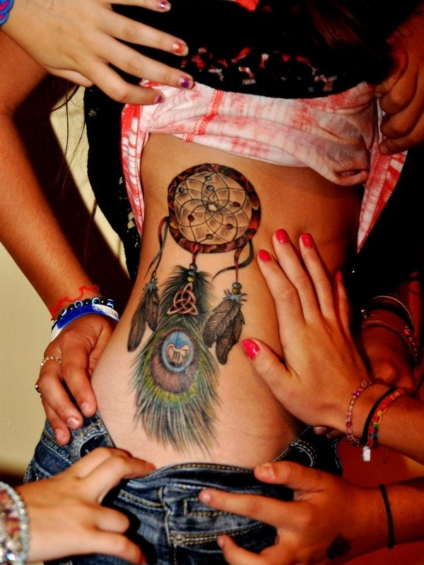 New school style colored side tattoo of incredible dream catcher