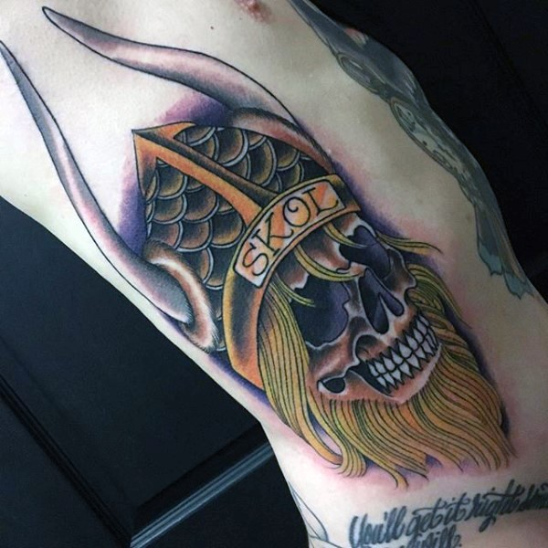 New school style colored side tattoo of viking skull with helmet and lettering