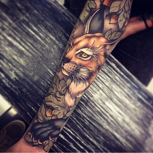 New school style colored sleeve tattoo of caracal in bush