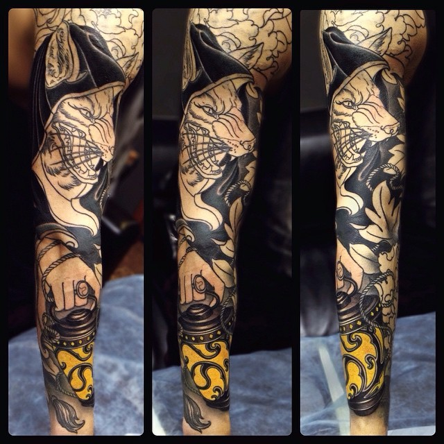 New school style colored sleeve tattoo of evil fox with lighter