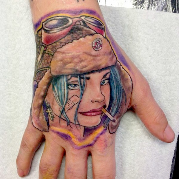 New school style colored smoking woman in hat tattoo on hand