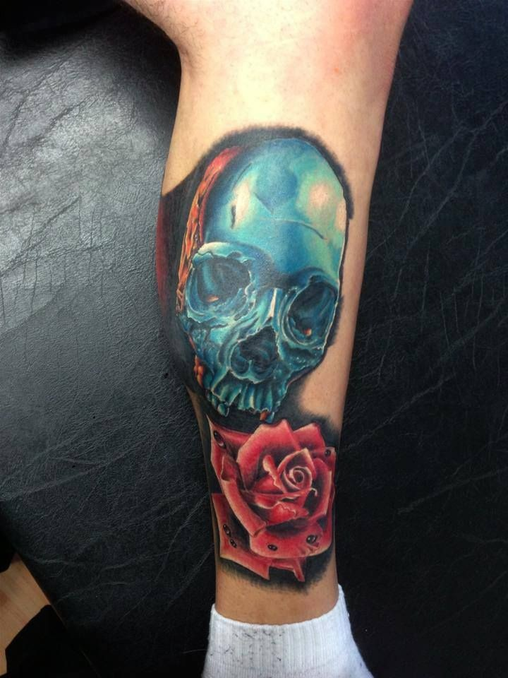 New school style colored tattoo of blue iron skull with rose