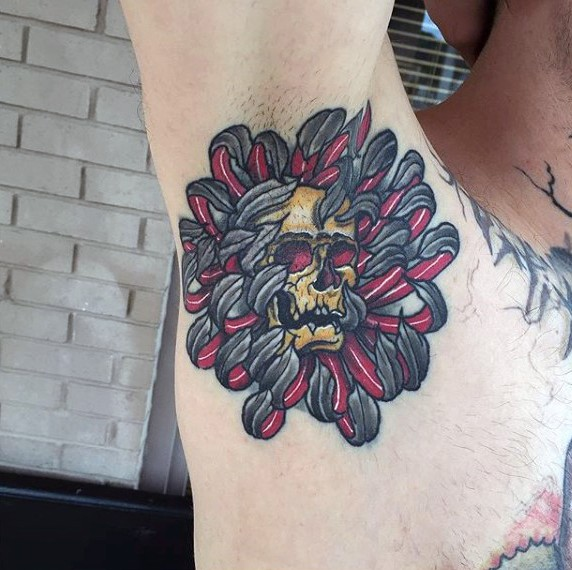 New school style colored tattoo of flower with human skull