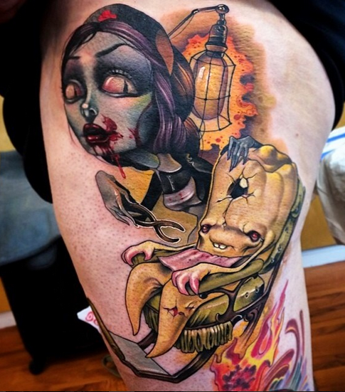 New school style colored thigh tattoo of bloody monster woman with funny monster