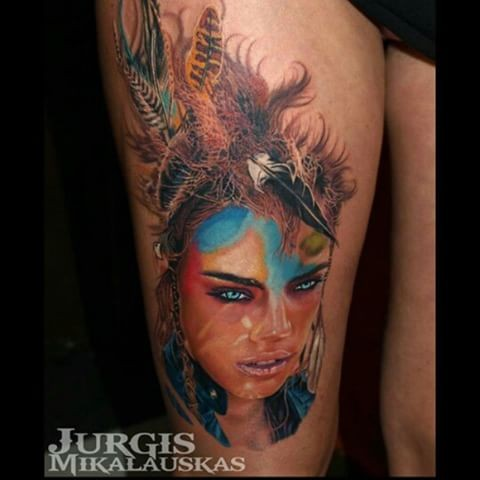 New school style colored thigh tattoo of woman with feather in hair