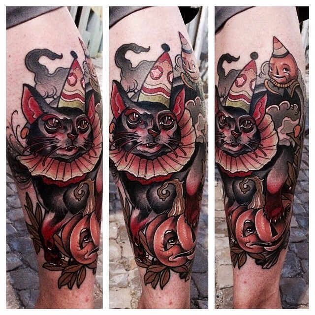 New school style colored thigh tattoo of creepy clown cat