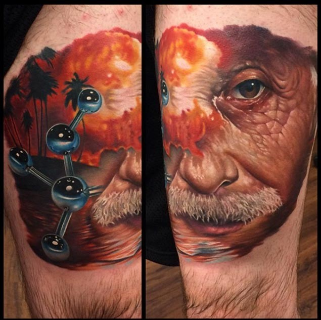 New school style colored thigh tattoo of Einstein face with atoms