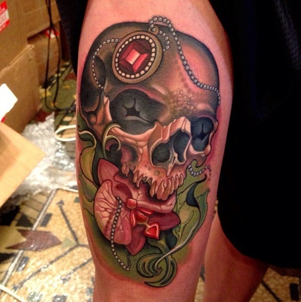 New school style colored thigh tattoo of human skull with jewelry