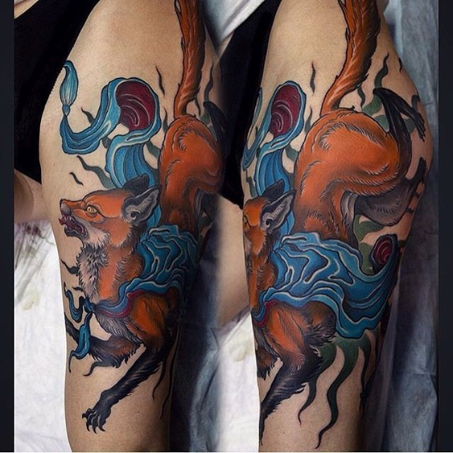New school style colored thigh tattoo of fox with ribbon