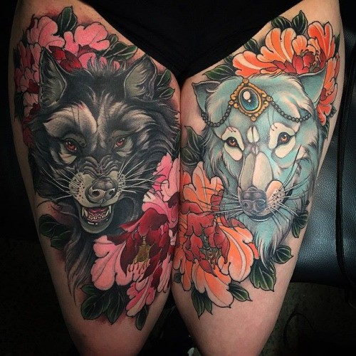 New school style colored thigh tattoo of evil wolf with cute wolf and flowers