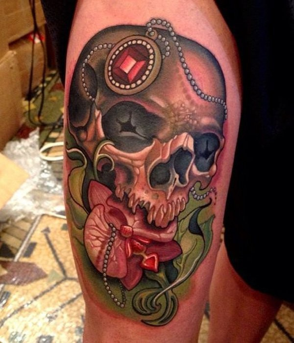 New school style colored thigh tattoo of human skull with jewelry and flowers